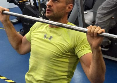 Dimi in the correct position for a wide grip lat pull