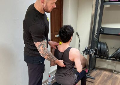 Seated Row with Mehmet, ensuring the back is locked in the correct posture